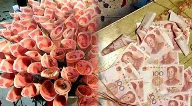 Sevgilisine çiçek yerine para buketi verdi!
